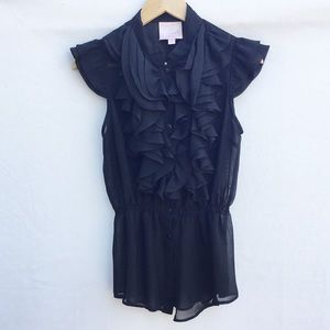 Romeo & Juliet Couture sheer ruffled black blouse.